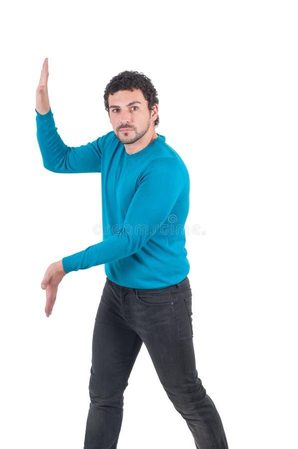 Mężczyzna pcha niewidzialną ścianę fotografia stock