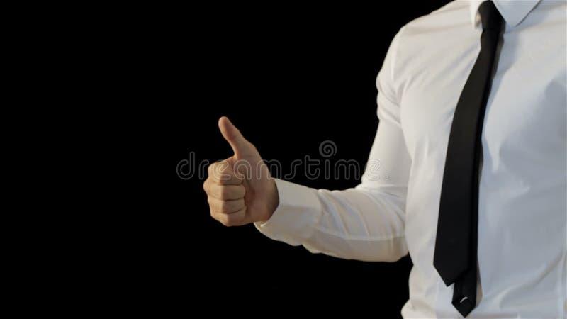 Mężczyzna pokazuje jego kciuk up zbiory