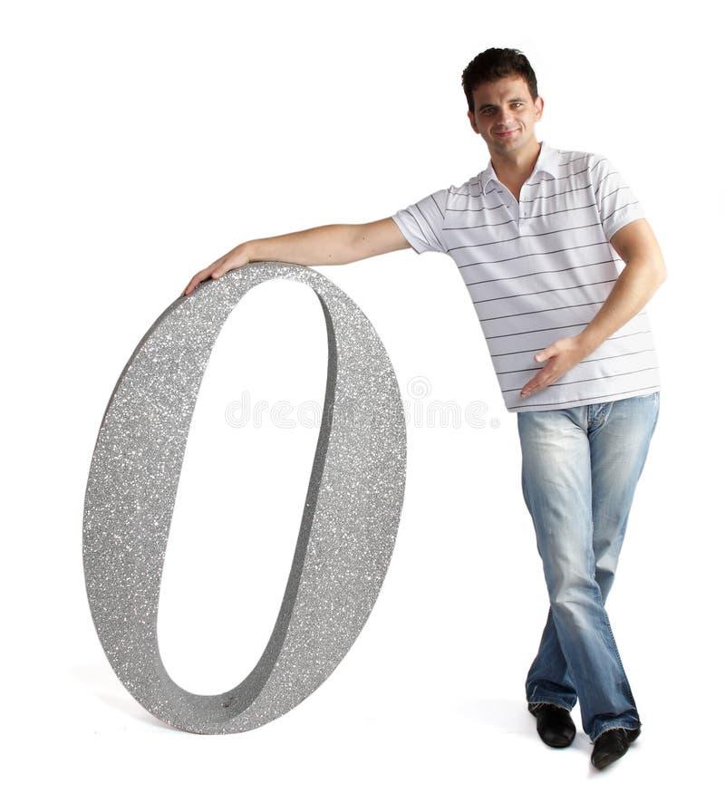 Mężczyzna pokazywać ogromną liczbę zero zdjęcie royalty free