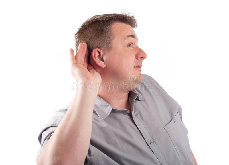 Mężczyzna próbuje słuchać ciebie zdjęcia stock