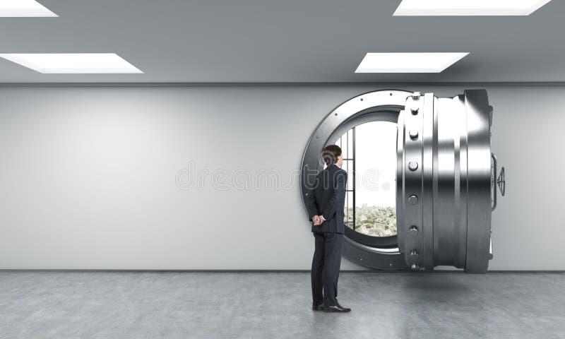 Mężczyzna przed otwierającą skrytką w banku, dolary inside zdjęcie stock