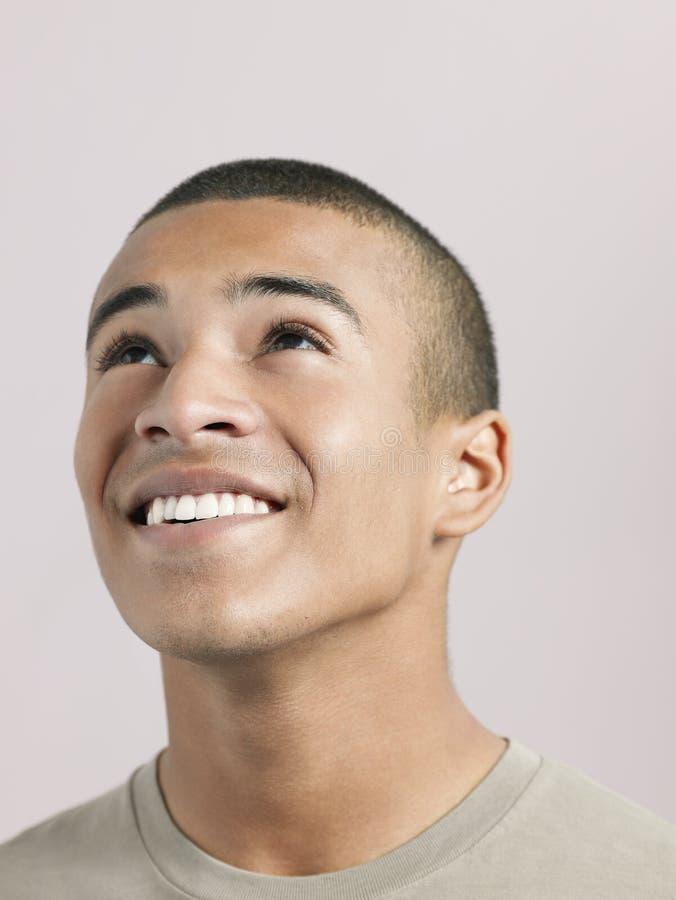 Mężczyzna Przyglądający Up, Uśmiechnięty I fotografia stock