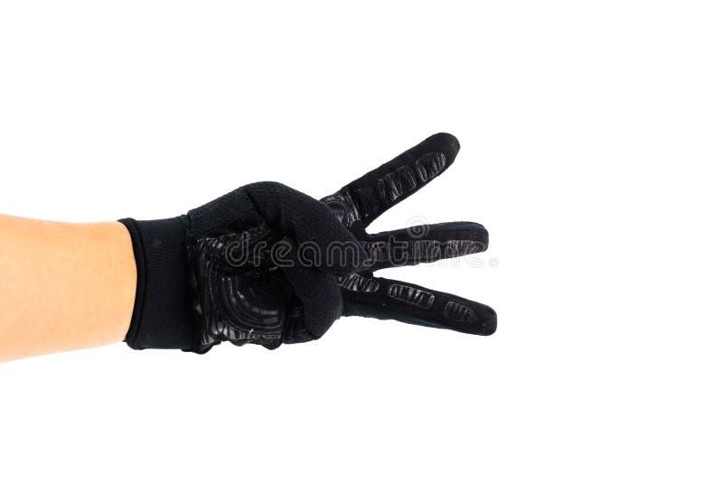 Mężczyzna ręka pokazuje palcowego symbol z czarną rękawiczką obraz stock