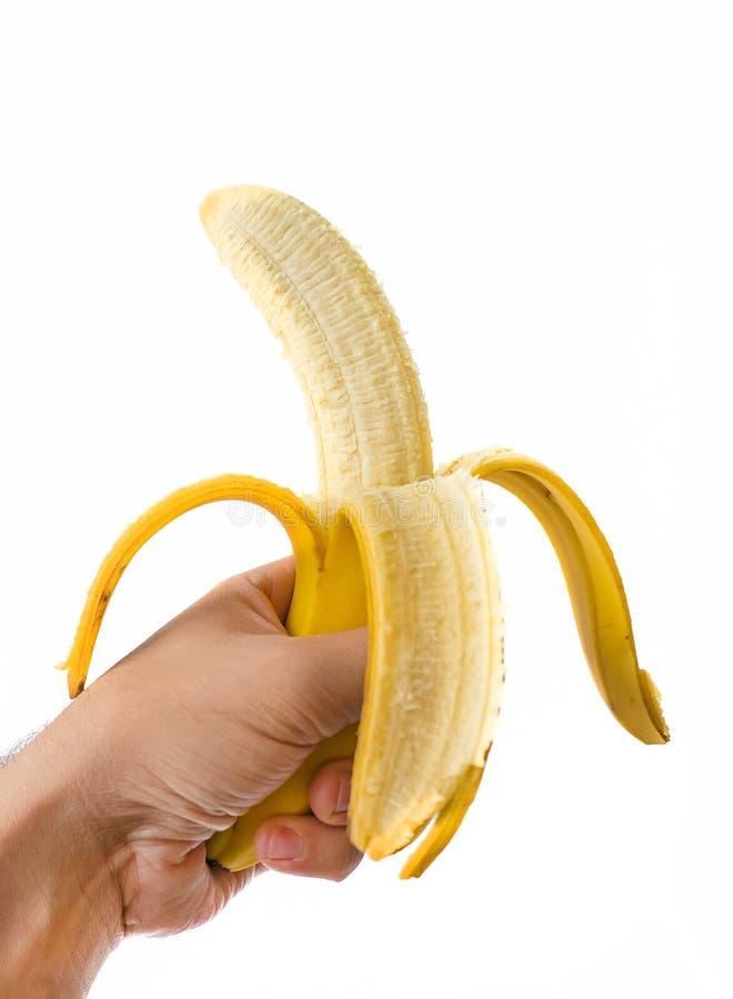 Mężczyzna ręki mienia banan odizolowywający zdjęcia stock