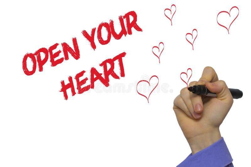 Mężczyzna ręki writing Otwiera twój serce z markierem na przejrzystym wytarciu zdjęcie stock
