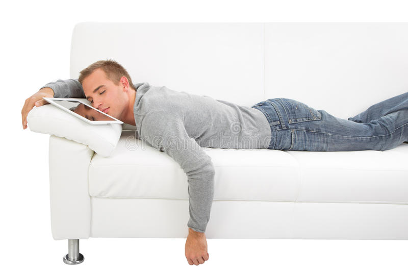 Mężczyzna sen z pastylka pecetem