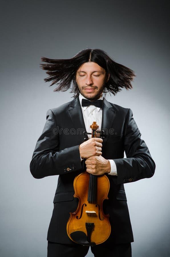 Mężczyzna skrzypcowy gracz w musican zdjęcie stock