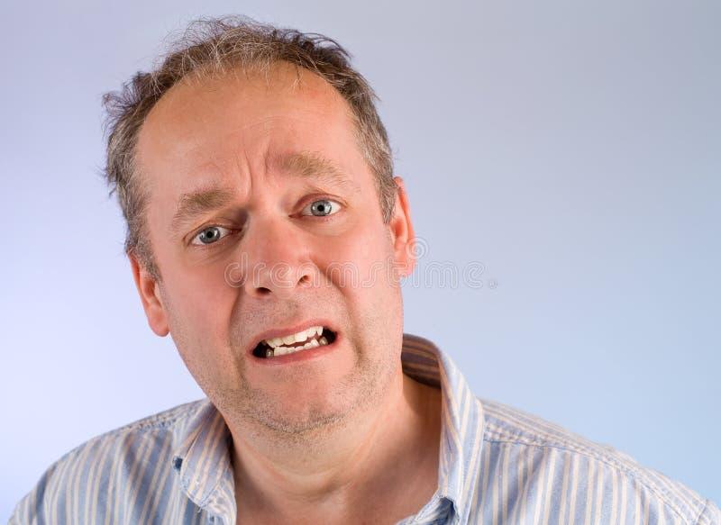 mężczyzna starzejący się środek coś nieszczęśliwy zdjęcie stock