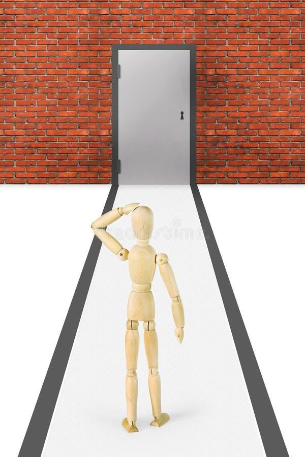 Mężczyzna stojaki przed ściana z cegieł z zamkniętym drzwi zdjęcia stock