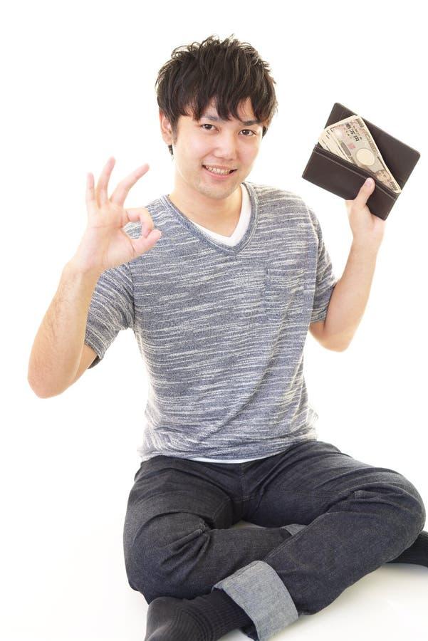 mężczyzna szczęśliwy pieniądze zdjęcia royalty free