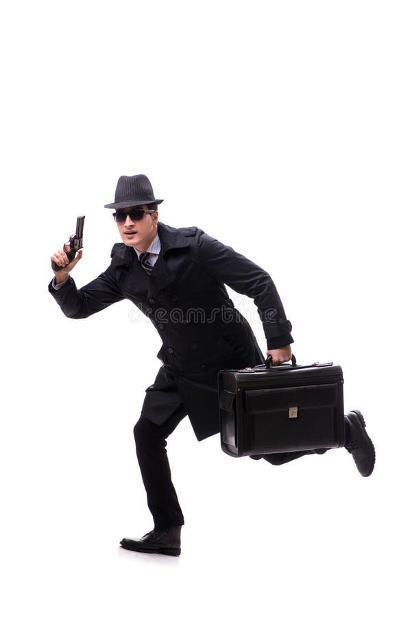 Mężczyzna szpieg z pistolecikiem odizolowywającym na białym tle zdjęcie stock