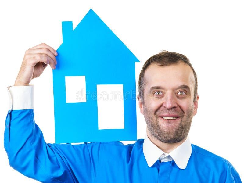 Mężczyzna trzyma błękita domu modela zdjęcia royalty free