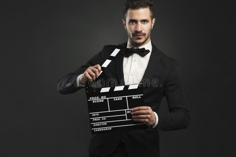Mężczyzna trzyma clapboard fotografia royalty free