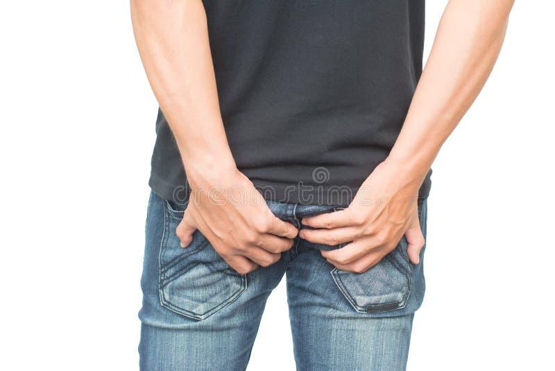 Mężczyzna trzyma jego półdupek biegunkę obrazy stock