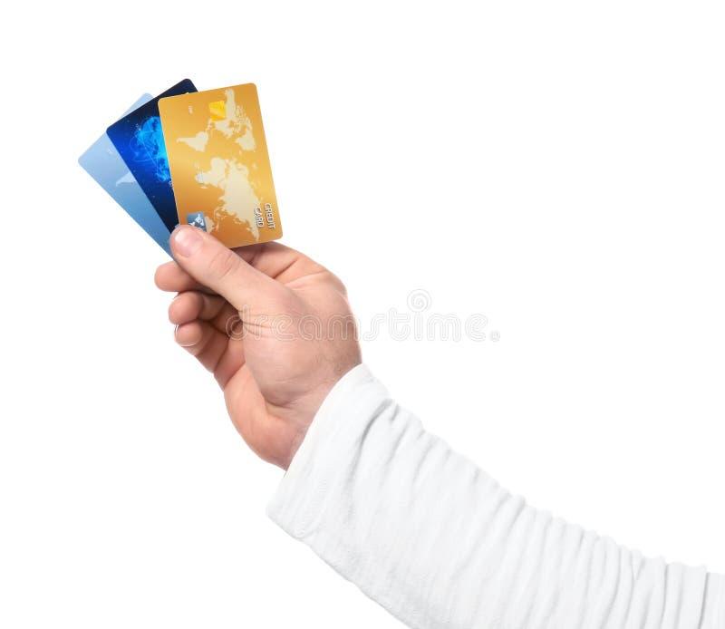 Mężczyzna trzyma kredytowe karty obraz royalty free