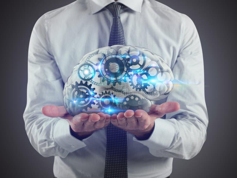 Mężczyzna trzyma mózg z przekładniami inside na jego rękach świadczenia 3 d fotografia stock