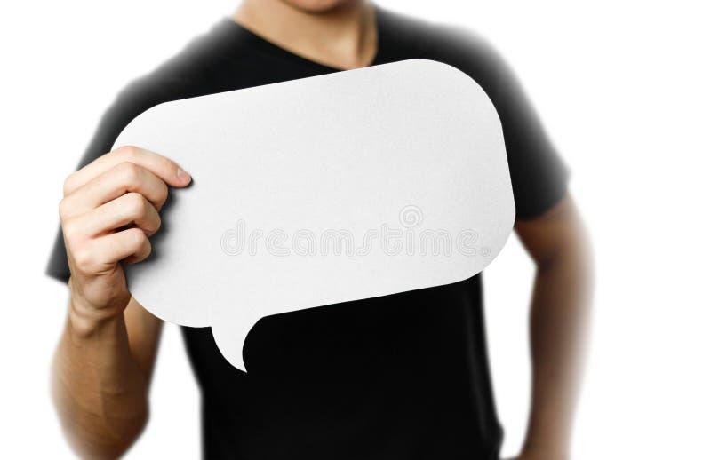 Mężczyzna trzyma pustego mowa bąbel z bliska Odizolowywający na bielu zdjęcie stock