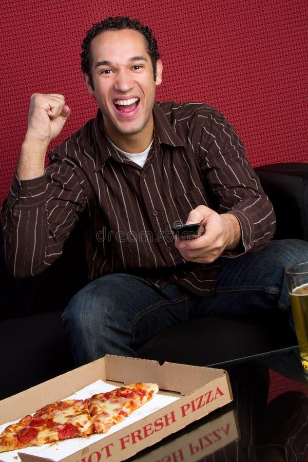 mężczyzna tv dopatrywanie obrazy stock