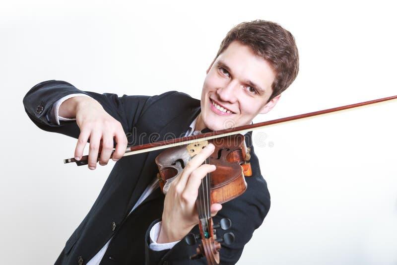 Mężczyzna mężczyzna ubierający elegancko bawić się skrzypce obraz royalty free