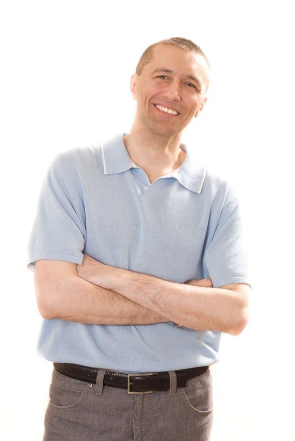 Mężczyzna w błękitny koszulowej pozyci obraz royalty free
