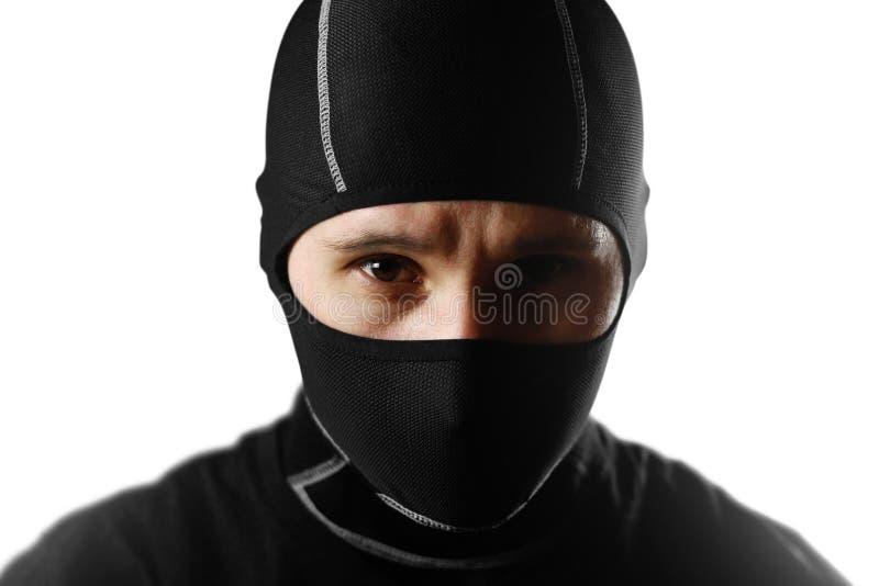 Mężczyzna w czarnym Balaclava z bliska Odizolowywający na bielu plecy obraz royalty free