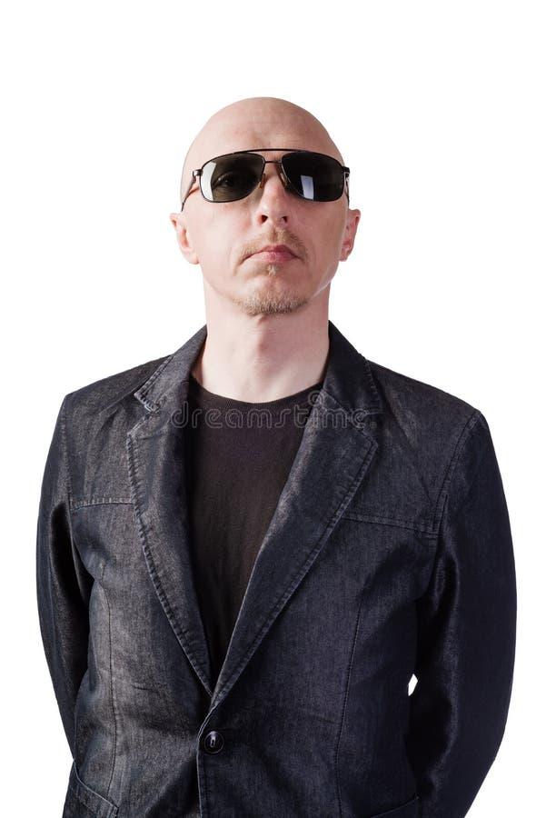 Mężczyzna w drelichowej kurtce z ciemnymi szkłami obraz royalty free