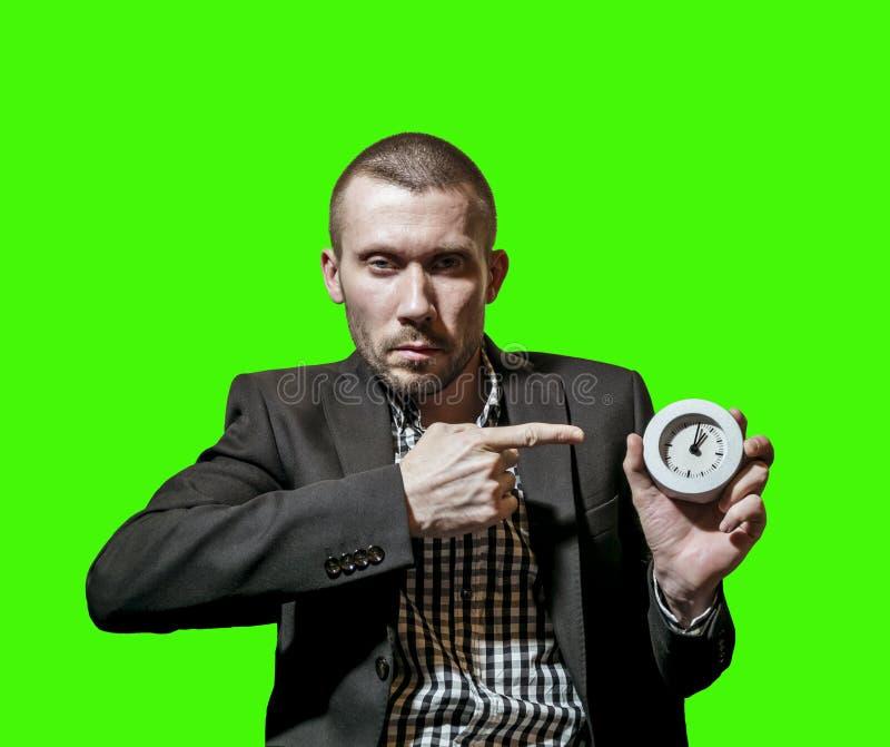 Mężczyzna w garniturze pokazuje na zegarze zdjęcia royalty free