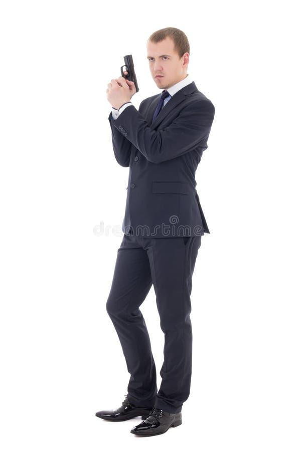 Mężczyzna w garniturze pozuje z pistoletem odizolowywającym na bielu obraz royalty free