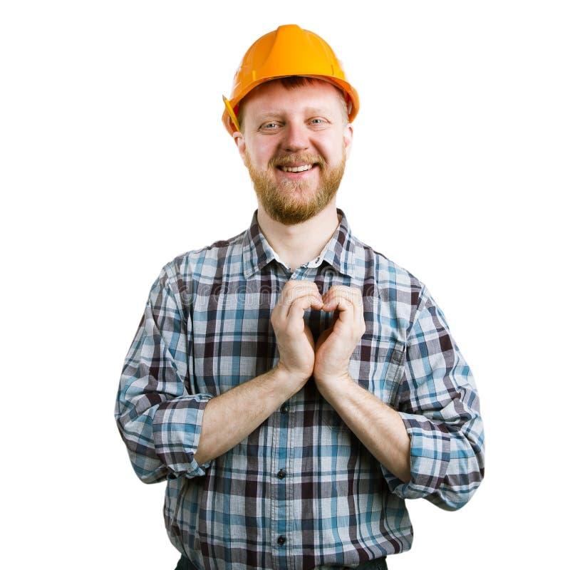 Mężczyzna w hełma seansie wręcza serce obrazy stock