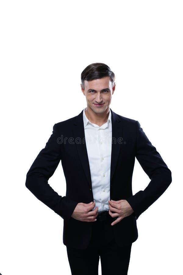 Mężczyzna w kostiumu prostuje jego kurtkę zdjęcie royalty free