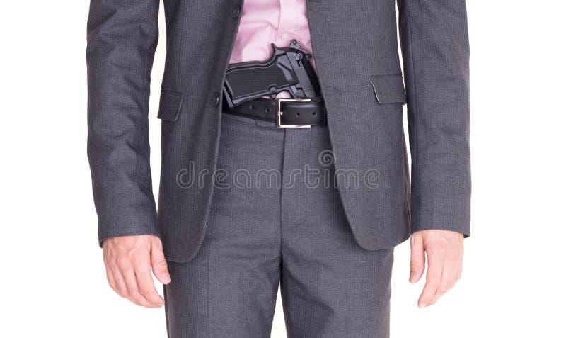 Mężczyzna w kostiumu z pistoletem, pistolecik obraz stock