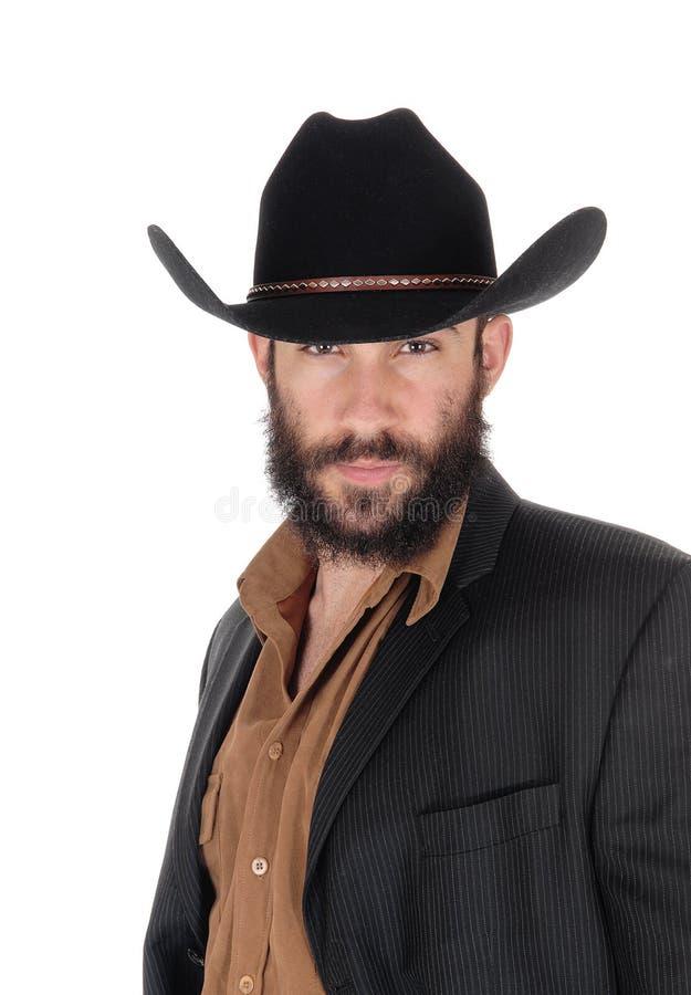 Mężczyzna w pasiastej kurtce i kowbojskim kapeluszu, w portreta wizerunku fotografia royalty free