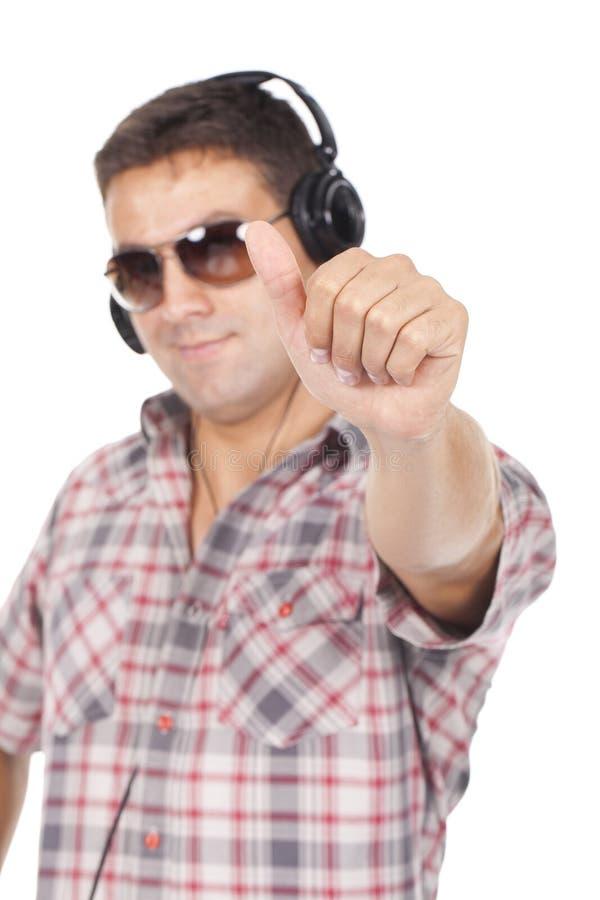 Mężczyzna w szkłach z hełmofonami na jego głowa fotografia stock