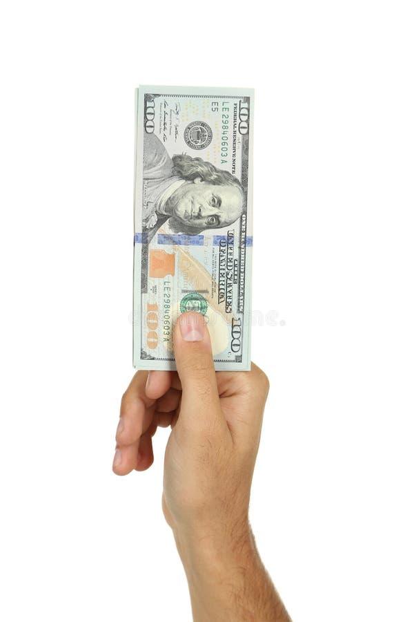 Mężczyzna wręczają mieniu sto dolarowych rachunków na białym tle zdjęcia royalty free