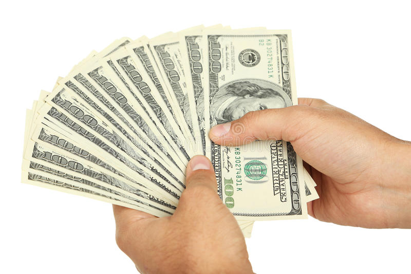 Mężczyzna wręczają mieniu sto dolarowych rachunków na białym tle obraz royalty free