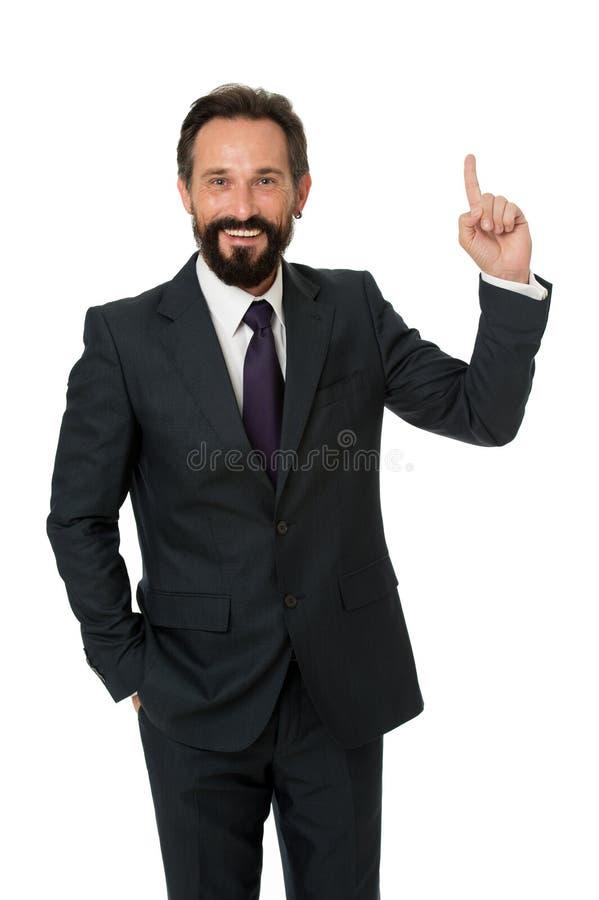 Mężczyzna wskazuje palec wskazujący reklamę odizolowywającą na bielu Mężczyzny brodaty dojrzały formalny kostium Biznesmena lub k zdjęcie royalty free
