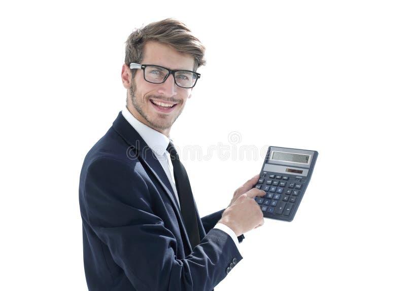 Mężczyzna wskazuje przy kalkulatorem obrazy royalty free