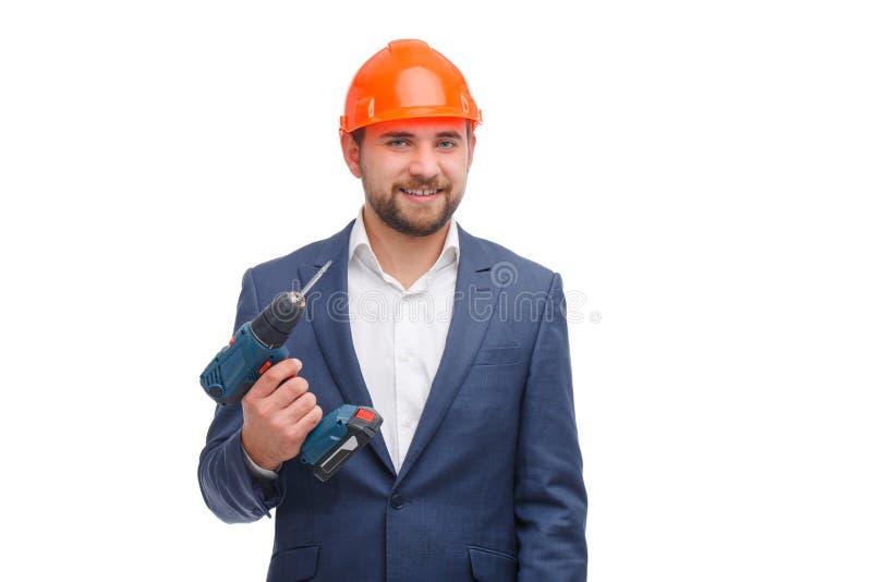 Mężczyzna z świderu, śrubokrętu lub budowy hełmem odizolowywającym na białym tle obrazy royalty free