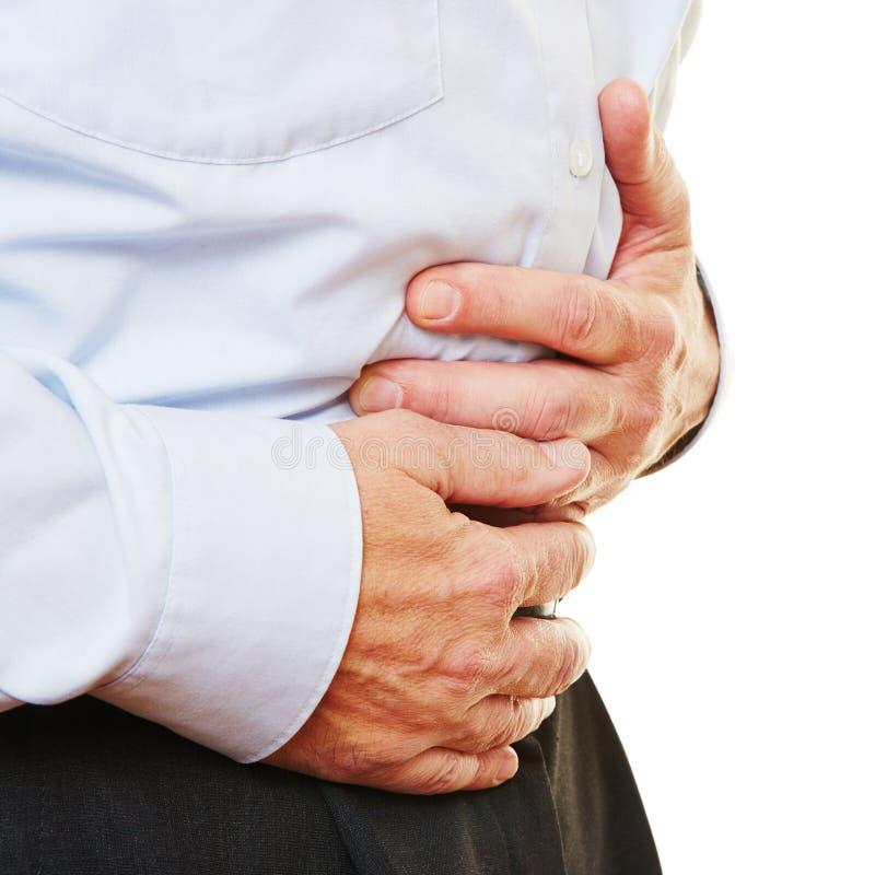 Mężczyzna z bellyache mienia żołądkiem obrazy stock