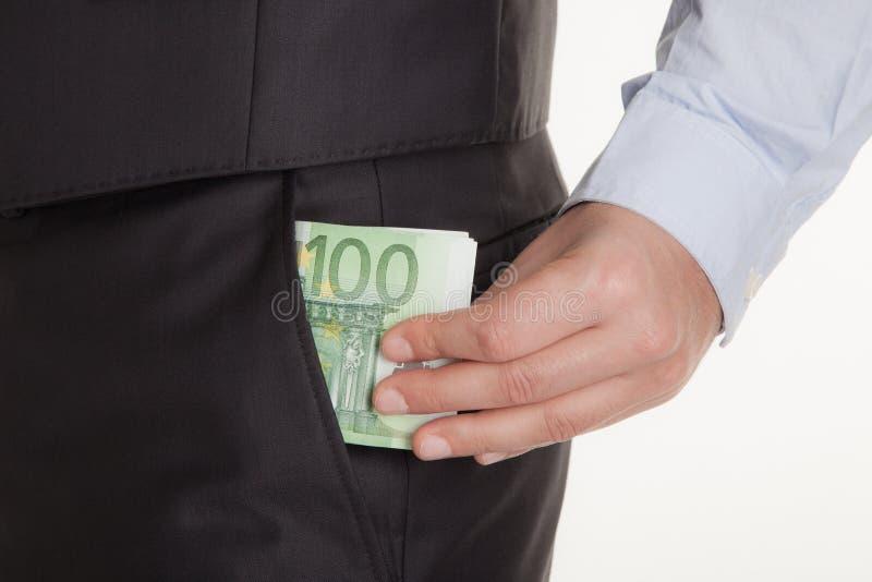 Mężczyzna z euro pieniądze w jego kostium kieszeniach odizolowywać na białym tle koncepcja finansowego obrazy royalty free