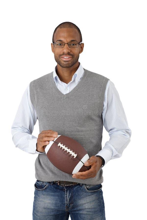Mężczyzna z Futbol amerykański fotografia royalty free