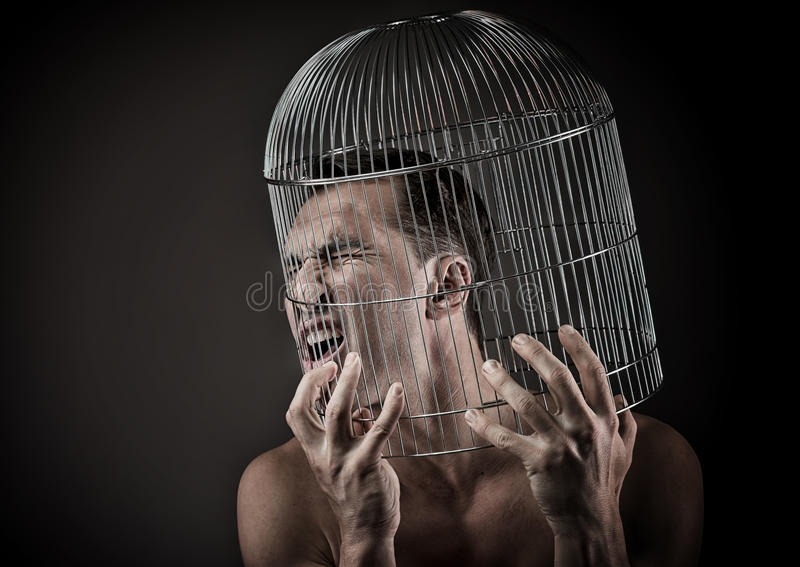 Mężczyzna z głową wśrodku birdcage fotografia royalty free