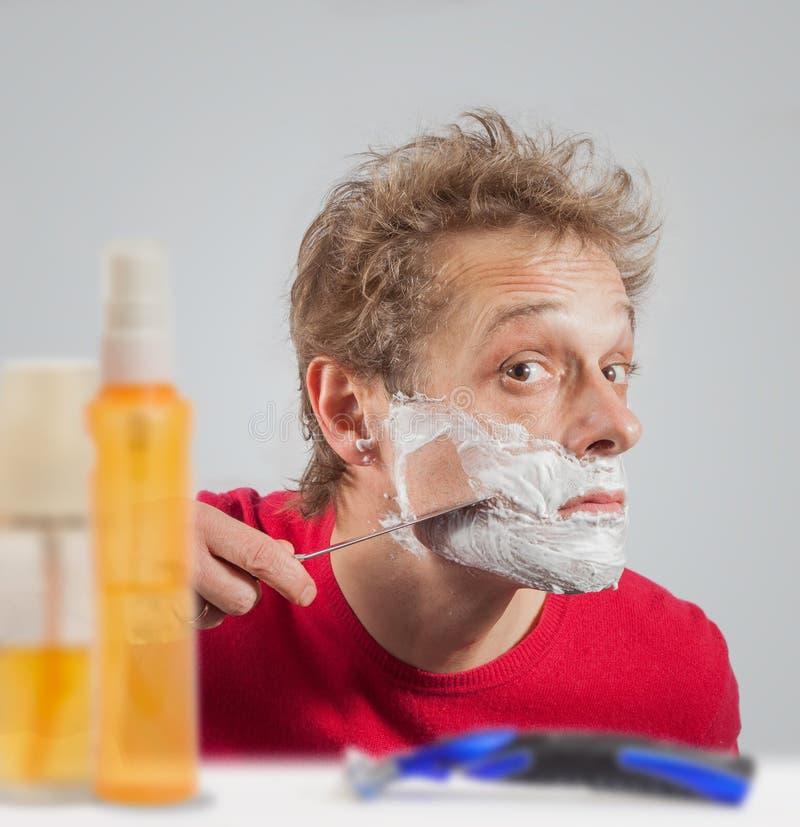 Mężczyzna z golenie śmietanką zdjęcia stock