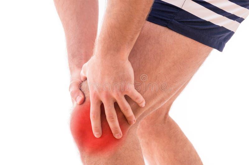 Mężczyzna z kolano bólem fotografia royalty free