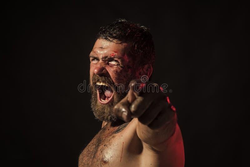 Mężczyzna z krwistą brodą, gniewny twarz punktu palec obraz royalty free