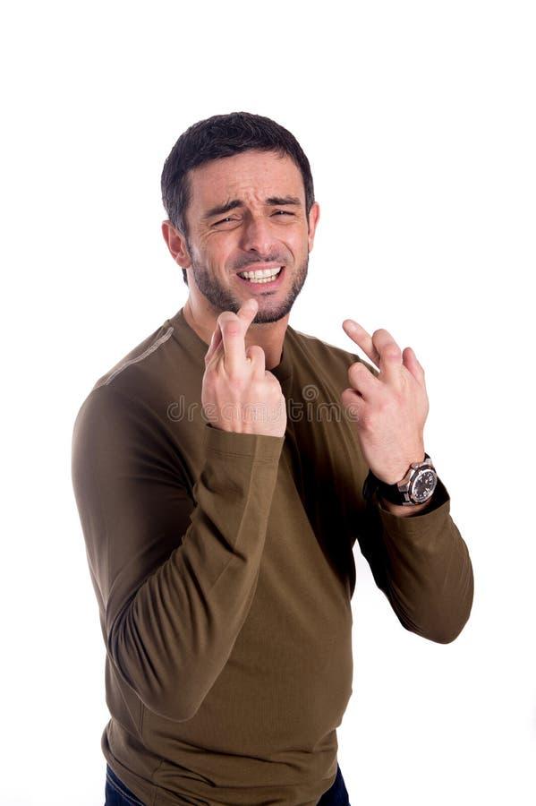 Mężczyzna z palcami krzyżującymi obraz stock