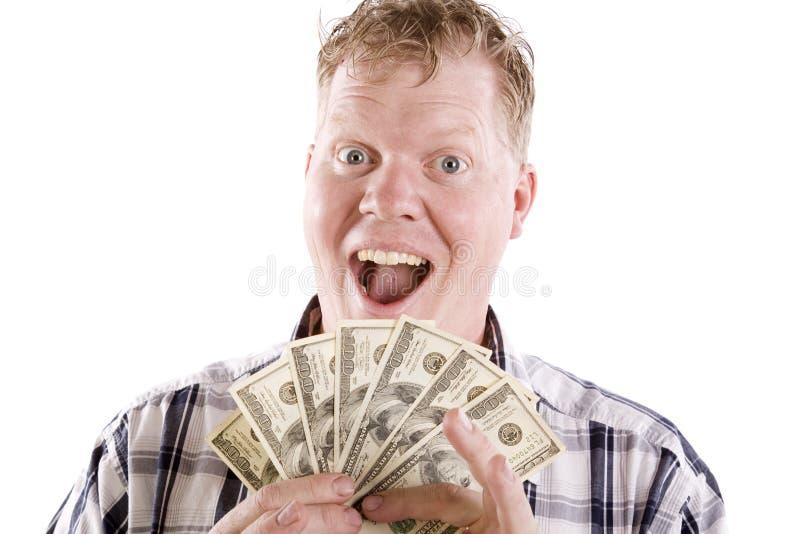 mężczyzna z podnieceniem pieniądze obraz royalty free