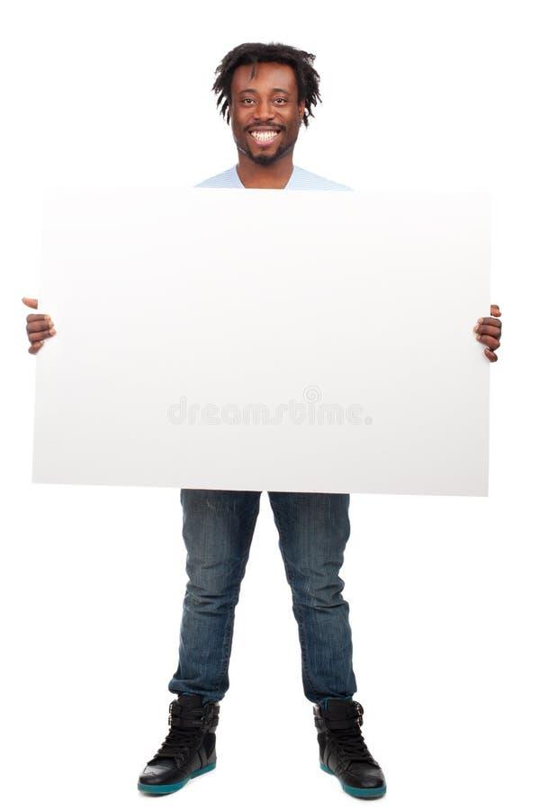 Mężczyzna z pustym billboardem obraz stock