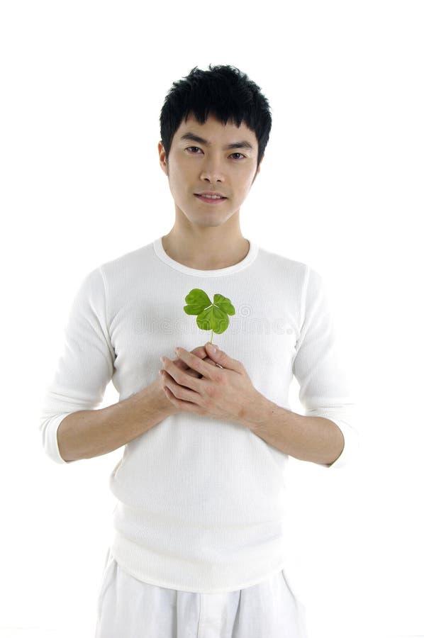 Mężczyzna z rośliną - fotografia stock