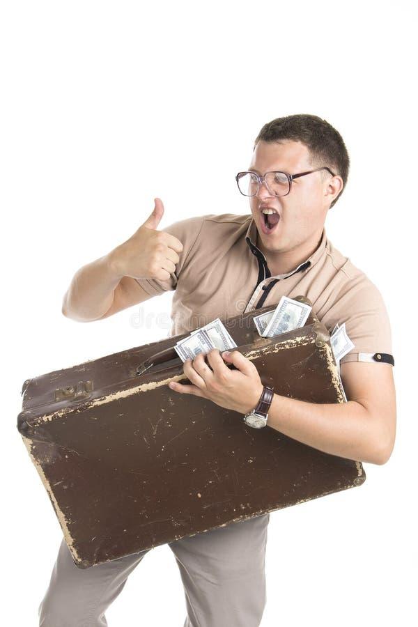 Mężczyzna z walizką pełno pieniądze zdjęcie royalty free